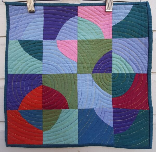 Improv circles in blues, purples and red